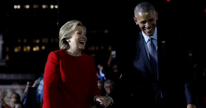 Then-President Barack Obama and former Secretary of State Hillary Clinton embrace during a campaign rally on Independence Mall on Nov. 7, 2016, in Philadelphia.
