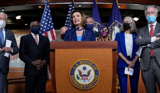 Speaker of the House Nancy Pelosi, surrounded by fellow congressional Democrats, speaks during a news conference on Capitol Hill in Washington on July 30.
