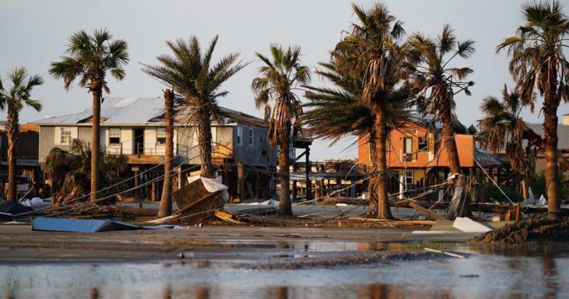 Storm debris litters a neighborhood in the wake of Hurricane Ida on Sept. 3, 2021, in Grand Isle, Louisiana.