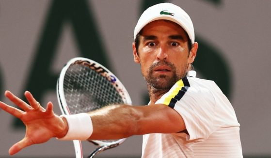 Jeremy Chardy of France plays a forehand in his First Round match against Stefanos Tsitsipas of Greece during Day One of the 2021 French Open at Roland Garros on May 30, 2021, in Paris, France.