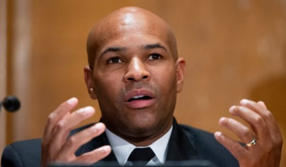 Then-Surgeon General Jerome Adams appears before a Senate Health, Education, Labor, and Pensions Committee hearing to discuss vaccines and protecting public health during the coronavirus pandemic on Sept. 9, 2020, in Washington D.C.