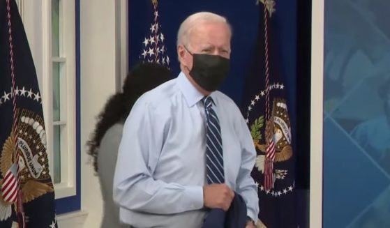 President Joe Biden speaks to reporters after receiving a COVID-19 booster shot at the White House on Monday.