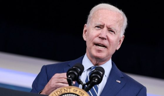 President Joe Biden delivers remarks ahead of receiving a third dose of the Pfizer-BioNTech COVID-19 vaccine in the South Court Auditorium in the White House in Washington, D.C., on Monday.