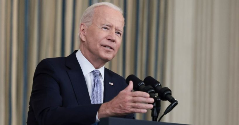 President Joe Biden gestures as he delivers remarks on his administration's COVID-19 response and vaccination program at the White House on Friday.