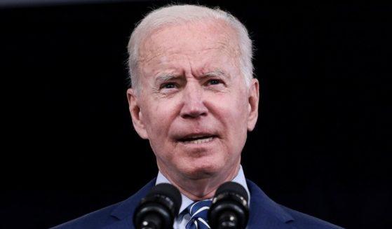 President Joe Biden speaks in the South Court Auditorium of the White House in Washington on Monday.