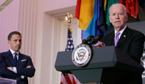 Then-Vice President Joe Biden speaks as his son, Hunter Biden, looks on at the World Food Program USA's Annual McGovern-Dole Leadership Award Ceremony at Organization of American States on April 12, 2016 in Washington, D.C.