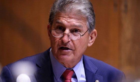 Democratic Sen. Joe Manchin of West Virginia listens during a committee hearing in the Dirksen Senate Office Building on June 10, 2021, in Washington, D.C.