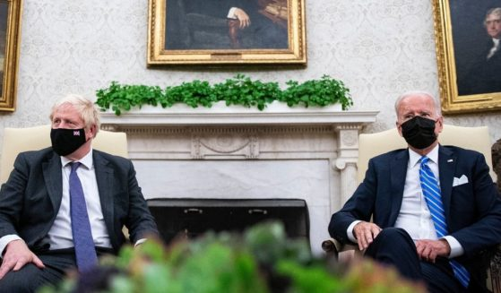 British Prime Minister Boris Johnson, left, meets with President Joe Biden in the Oval Office of the White House in Washington on Tuesday.