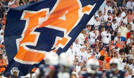 Cheerleaders wave the Auburn flag during the Tigers' game against the Akron Zips at Jordan-Hare Stadium in Auburn, Alabama, on Saturday.