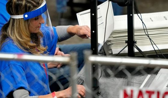 Ballots cast in the 2020 general election in Maricopa County, Arizona, are examined and recounted by contractors working for the Florida-based company Cyber Ninjas at Veterans Memorial Coliseum in Phoenix on May 6.