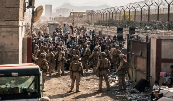 U.S. Marines stand guard at a checkpoint during the evacuation at Hamid Karzai International Airport in Kabul, Afghanistan, on Aug. 21.