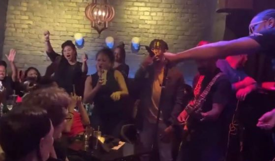 San Francisco Mayor London Breed, standing, left, has been criticized for partying maskless at a nightclub despite her city's strict mask mandates.