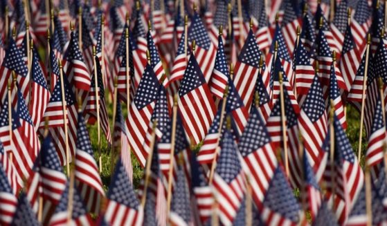A field of 2,977 flags honoring those who died on Sept.11, 2001, is displayed during a 9/11 memorial at the Nixon Presidential Library and Museum in Yorba Linda, California, on Saturday.
