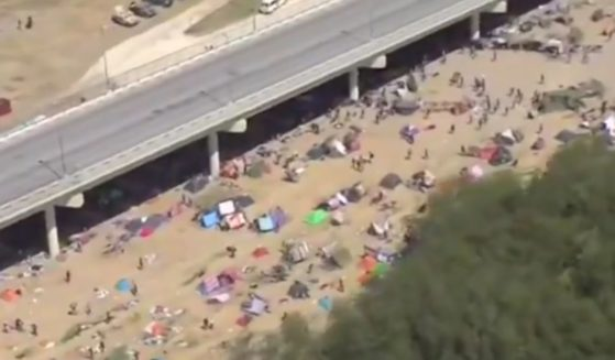 A Fox news crew captured video of thousands of migrants camped around a bridge in Texas Friday, Sept. 17, 2021, after crossing illegally into the U.S.
