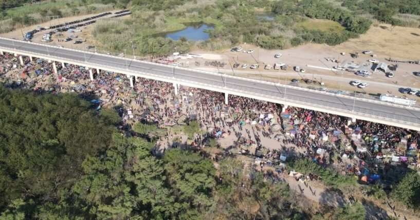 Thousands of migrants are seen in a camp under the international bridge in Del Rio, Texas.