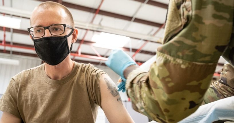 A Fort Knox soldier receives a vaccine in this file photo from Sept. 9, 2021. The Biden administration wants any service member who refuses the vaccine to be dishonorably discharged.