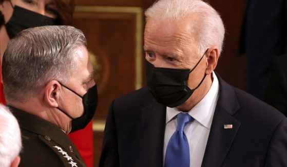 President Joe Biden, right, speaks with Gen. Mark A. Milley, chairman of the Joint Chiefs of Staff, at the US Capitol on April 28, 2021.