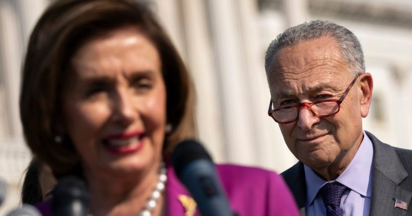 Speaker of the House Nancy Pelosi, left, speaks as Senate Majority Leader Chuck Schumer looks on during a news conference about climate change outside the U.S. Capitol on July 28, 2021, in Washington, D.C.