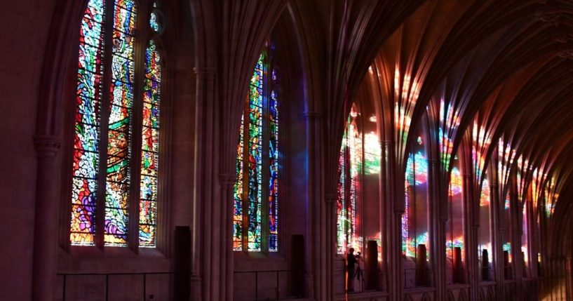 Sunlight filters through the stained glass windows inside the National Cathedral in Washington, DC in this file photo from June 20, 2017.
