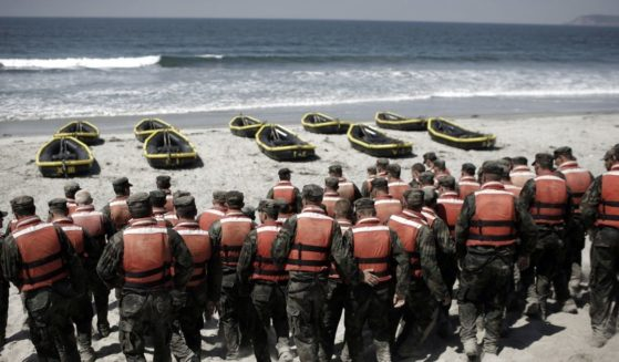 Navy SEAL trainees participate in a Hell Week exercise on a beach in Coronado, California, in August 2010.