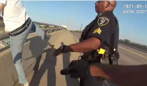 Two Metra police officers rushed to save a man as he attempted to jump off a bridge in Blue Island, Illinois.