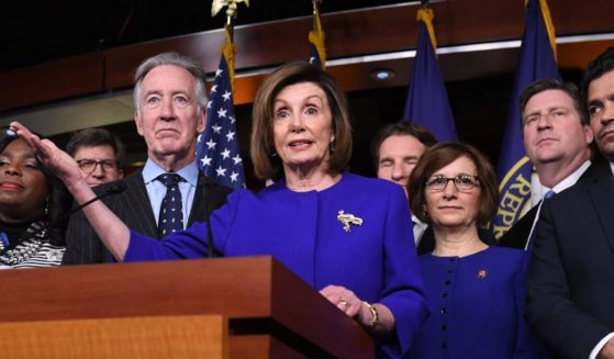 Speaker of the House Nancy Pelosi and House Ways and Means Committee Chairman Richard Neal, left, speak at a news conference on Capitol Hill in Washington, D.C., on Dec. 10, 2019.