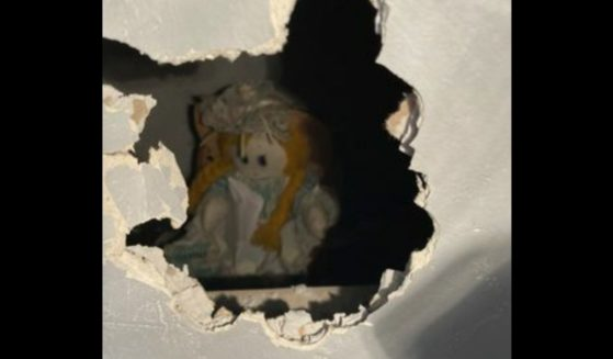 An old ragdoll was found behind the drywall of a home in the Walton area of Liverpool, England.