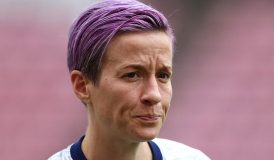 U.S. soccer star Megan Rapinoe looks on as she warms up prior to a match against Canada in the Tokyo Olympic Games at Kashima Stadium in Ibaraki, Japan, on Aug. 2.