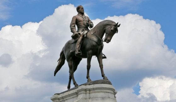 A statue of Confederate Gen. Robert E. Lee stands in the middle of a traffic circle on Monument Avenue in Richmond, Virginia.