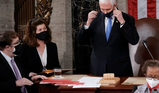Senate Parliamentarian Elizabeth MacDonough, second from left, works beside then-Vice President Mike Pence during the certification of Electoral College ballots in the presidential election in the House chamber at the Capitol in Washington on Jan. 6.