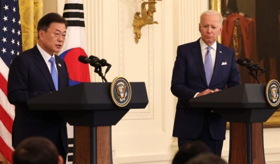 President Joe Biden, right, listens as South Korean President Moon Jae-in speaks at a joint news conference in the East Room of the White House on May 21, 2021, in Washington, D.C.