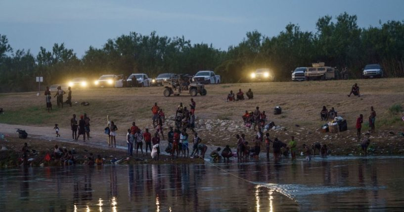Vehicles from the U.S. Border Patrol, the National Guard and the Texas Department of Public Safety in Del Rio, Texas, shine their lights on the Rio Grande across from Ciudad Acuna, Mexico, on Tuesday.