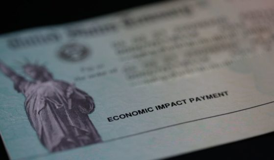 An economic impact payment, also referred to as a stimulus check, issued by the United States Treasury with address and routing numbers removed is displayed on a black background on May 15, 2021, in North Las Vegas, Nevada.