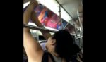 A woman tears down offensive advertising signs on a New York City subway.
