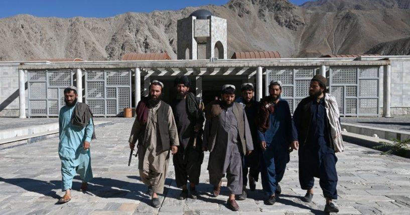 Taliban fighters walk near the tomb of Afghan mujahedeen leader Ahmad Shah Massoud in Saricha in Panjshir Province on Sept. 15.