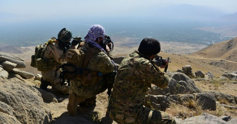Anti-Taliban forces patrol on a hilltop in Panjshir province, Afghanistan, on Wednesday.