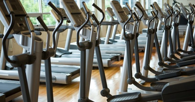 Rows of treadmills are pictured in the stock image above.