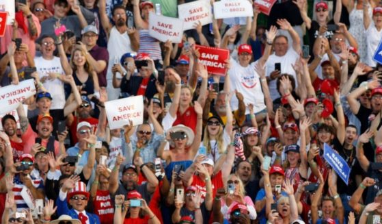 Supporters of former President Donald Trump cheer during his campaign-style rally in Wellington, Ohio, on June 26.
