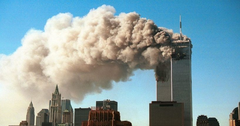 Smoke pours from the twin towers of the World Trade Center after they were hit by two hijacked airliners in a terrorist attack on Sept. 11, 2001, in New York City.