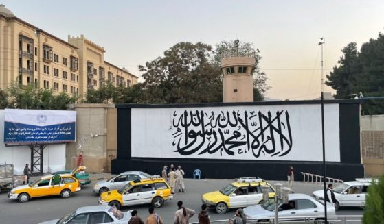 A mural featuring the flag of the Taliban is seen on a wall of the former U.S. Embassy compound in Kabul, Afghanistan.