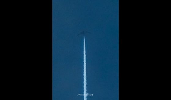An unidentified aircraft is seen flying above the Pacific Ocean on Thursday.