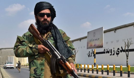 A Taliban fighter is seen standing on the street near Zanbaq Square in Kabul in Afghanistan on Thursday.