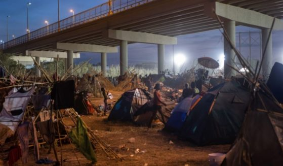 A group of mostly Haitian migrants is seen living in tents at the US-Mexico border in Del Rio, Texas, on Tuesday.
