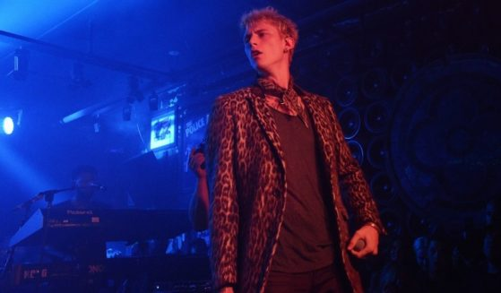Machine Gun Kelly is seen performing onstage at the John Varvatos x MGK Fashion Week Concert in New York City on Sept. 7, 2017. (