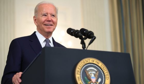 President Joe Biden delivers remarks from the State Dining Room at the White House on Friday.