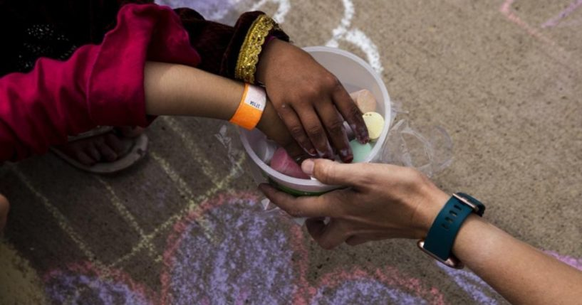 Afghan children are seen playing with chalk at Fort McCoy in Wisconsin in a Tuesday photo provided by the U.S. Army.