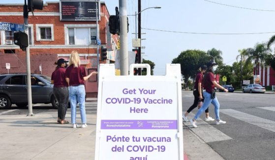 A sign containing information about where to obtain the COVID vaccine is seen on Aug. 17 in Los Angeles.