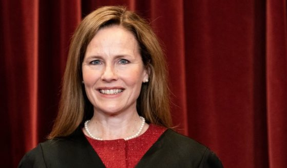 Associate Justice Amy Coney Barrett poses for a group photo with the other Justices at the Supreme Court in Washington, D.C., on April 23, 2021.