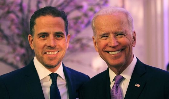 Hunter and Joe Biden attend a World Food Program USA event at the Organization of American States in Washington on April 12, 2016.