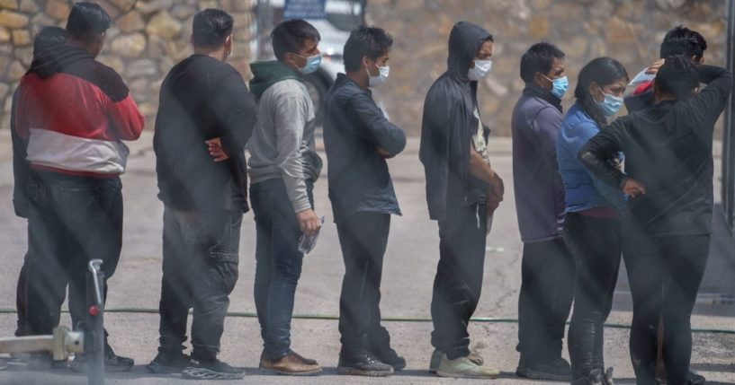 Migrants are seen being processed at the Paso Del Norte International Bridge in El Paso, Texas, on Sept. 1, 2021.